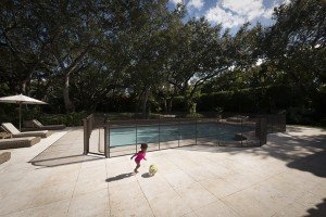 pool safety fence brown with baby and ball